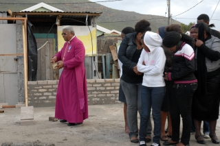 His Grace, the retired Archbishop Ndungane blessing the foundations.