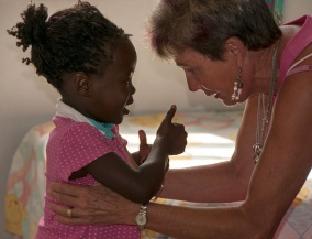 Diana Higgs with one of the children.